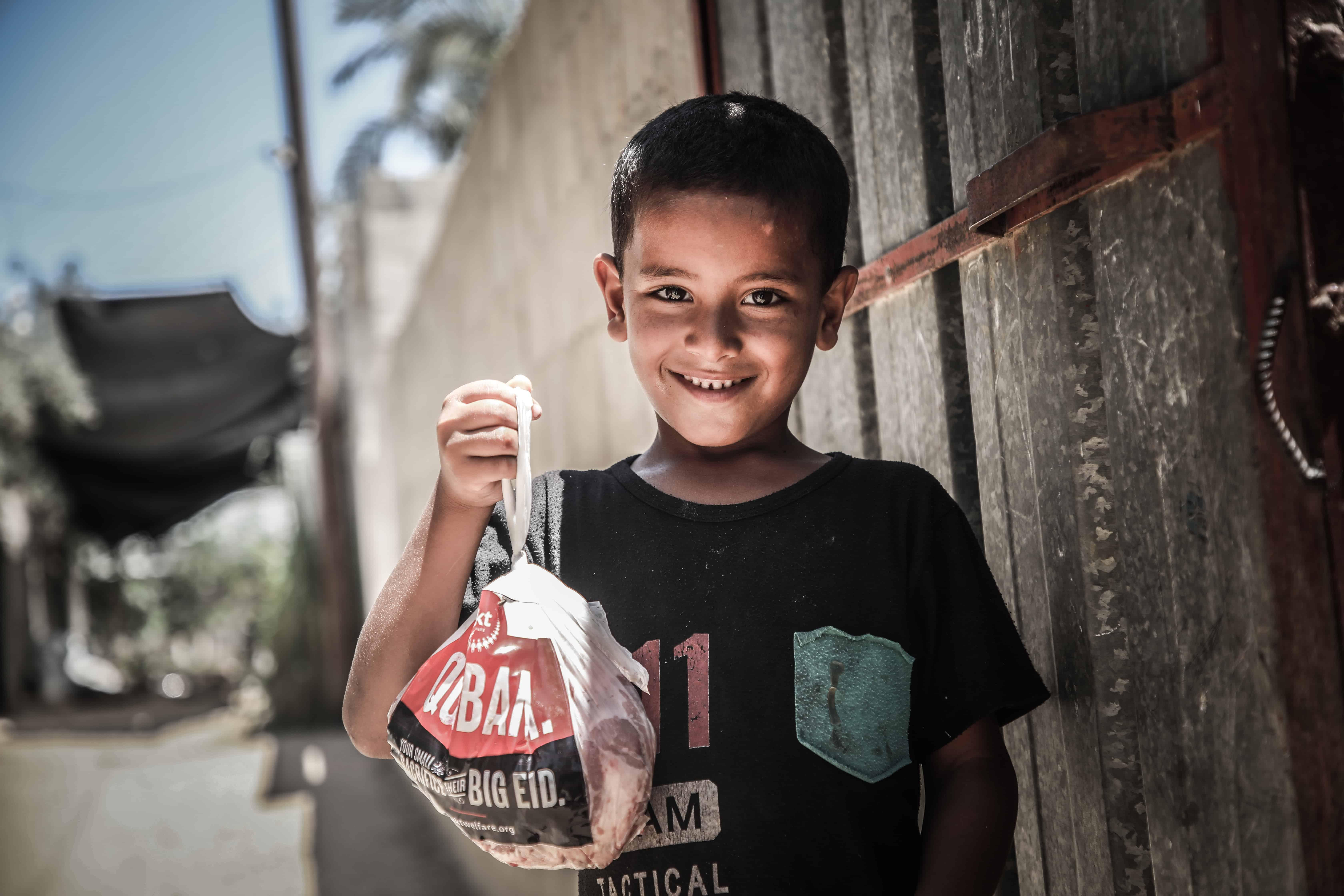 Vulnerable Kid Holding Qurbani Meat Bag